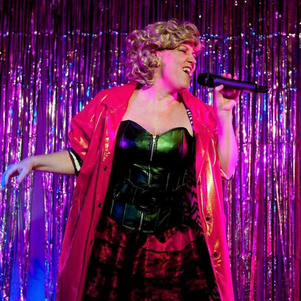 Annemarie Lloyd live on stage singing as Bette Midler in the Divine Miss M rockumentary