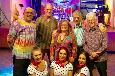 Feeling Groovy, the Cool River Show, cast poses for a group shot. - All Things Entertainment