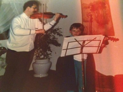 Vov Dylan and his father practicing violin together. All Things Entertainment
